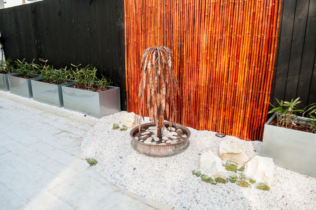 george-stone-garden-with-metal-water-feature